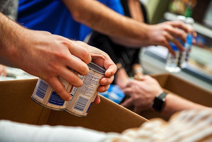 Volunteers preparing charity boxes